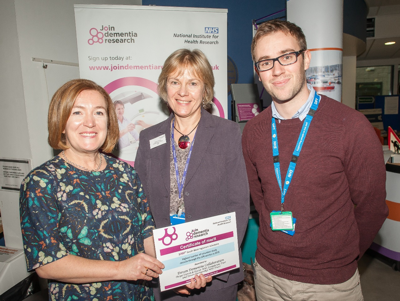 """Pictured above is Dr Ruth Newman and Jon Richards of Devon Partnership NHS Trust when presented with an award last year for successful recruitment of patients through the Devon Dementia Collaboration to research studies in the South West. <a href=""""http://www.grw.photography"""" target=""""_blank"""">GRW Photography</a>"""